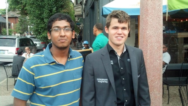 Priyadharshan posing for a picture with World Champion Magnus Carlsen