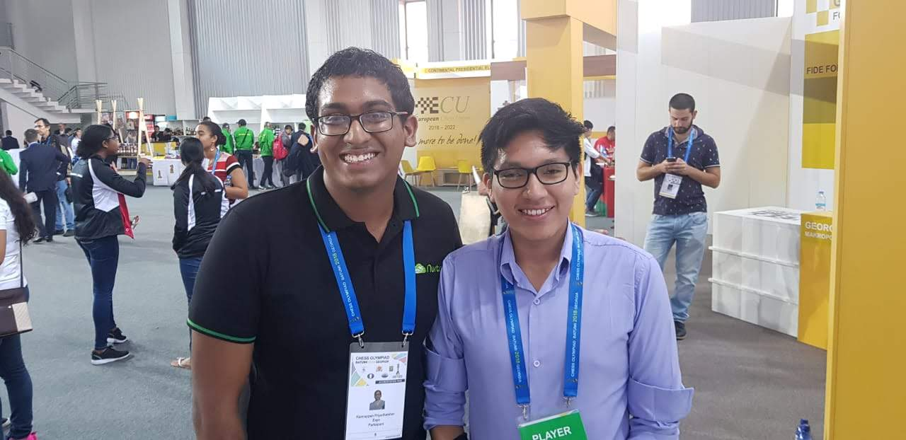 Priyadharshan with #1 ranked chess player from Peru, GM Jorge Cori
