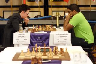 Priyadharshan playing against World Championship Challenger GM Fabiano Caruana