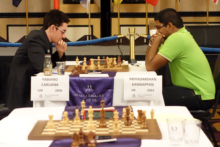 Priyadharshan playing against World Championship Challenger GM Fabiano Caruana